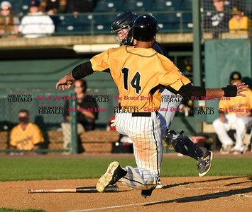 060916 Wesley Bunnell   Staff  New Britain took on the Somerset Patriots on Thursday evening at New Britain Stadium . Michael Crouse #14 is safe at home on a suicide squeeze.