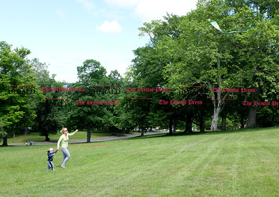 060916 Wesley Bunnell | Staff  Justina Dick of New Britain spent time in Walnut Hill Park on Thursday afternoon flying a kite with her son Alexander Dick age 2.