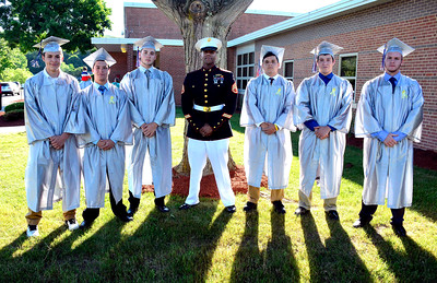 6/9/2016 Mike Orazzi | Staff Bristol Eastern High School graduates entering the military with Staff Sgt. Derek Cromwell at  BEHS Thursday evening.  Left to right: David Anderle, Joe Colangelo, Anthony Circosta, Cromwell, Pat McCall, Alex Nimchek and Ryan Goulet.