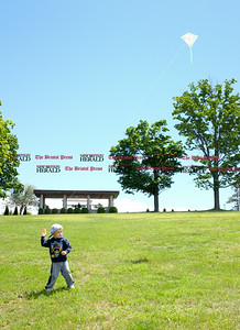 060916 Wesley Bunnell | Staff  Alexander Dick, age 2, of New Britain flies his kite in Walnut Hill Park on Thursday afternoon.