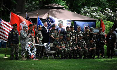 6/9/2016 MIke Orazzi | Staff Bristol Mayor Ken Cockayne with Lao Hmong veterans at the Traveling Vietnam Wall That Heals on Memorial Blvd. in Bristol Thursday morning.
