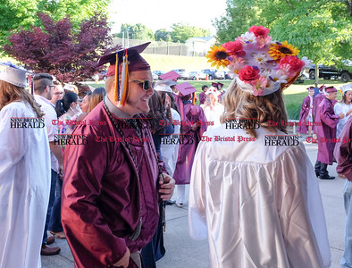 060916 Wesley Bunnell | Staff  Bristol Central High School held commencement their commencement ceremony on Thursday evening. From Krzysztof Nizielski wearing sunglasses as he walks into school with Paige Daly.