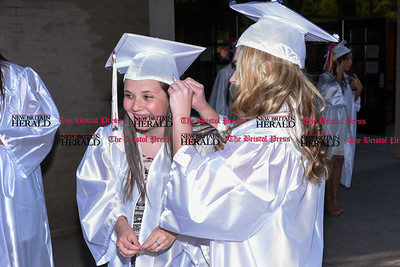 060916 Wesley Bunnell | Staff  Bristol Central High School held commencement their commencement ceremony on Thursday evening. Shana Cox gets help from Nicole Wolf with keeping her hat in place.