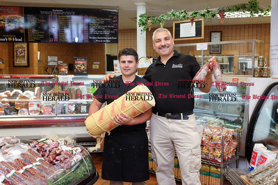 060916 Wesley Bunnell | Staff  Angelo's Market in New Britain has won a Best of Award for 2016. From L manager Salvatore Avella holding approximately 75lbs of provolone cheese and Joe Tropea with sopressata.