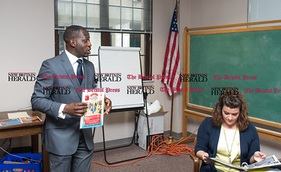 032116 Wesley Bunnell | Staff  Akintunde Sgunro gave a presentation on his book, Mama Stitches, to Mayor Erin Stewart & the executive committee of the Workplace to End Homelessness on March 21st.  Tunde with Mayor Erin Stewart.