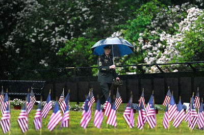 6/11/2016 Mike Orazzi | Staff U.S. Army Veteran Andre St. Laurent walks through The Traveling Vietnam Wall That Heals on Saturday in Bristol's Memorial Blvd.