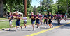 061016 Wesley Bunnell | Staff<br /> <br /> The Law Enforcement Torch Run for the Special Olympics came through Newington, New Britain, Berlin & Southington on Friday.  The Berlin team near the intersection of Percival Ave & Sheldon St.  A bicycle cop takes a selfie towards the rear of the pack.
