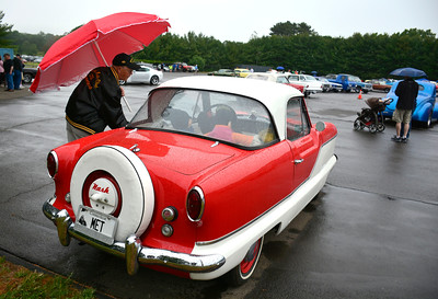 6/11/2016 Mike Orazzi | Staff Roger Nevers with his 1959 Nash Metropolitan at The fifth-annual Wings and Wheels Festival at Robertson Airport Saturday.