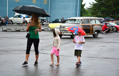 6/11/2016 Mike Orazzi | Staff Melissa Revelle and her children Juliana Caiden while at The fifth-annual Wings and Wheels Festival at Robertson Airport Saturday.
