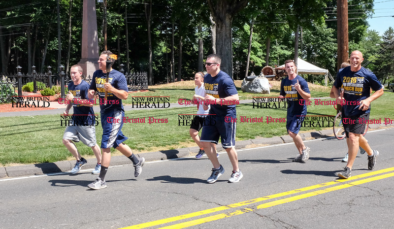 061016 Wesley Bunnell | Staff<br /> <br /> The Law Enforcement Torch Run for the Special Olympics came through Newington, New Britain, Berlin & Southington on Friday.  The runners pass Kensington Congregation Church in Berlin.