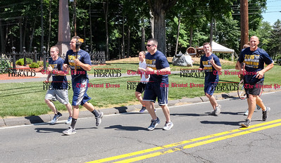 061016 Wesley Bunnell | Staff  The Law Enforcement Torch Run for the Special Olympics came through Newington, New Britain, Berlin & Southington on Friday.  The runners pass Kensington Congregation Church in Berlin.