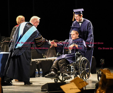 061016 Wesley Bunnell | Staff  The Oakdale Theater in Wallingford was the scene for the 2016 Newington High School Graduation. Travis King accepts his diploma and shakes hands with staff members.