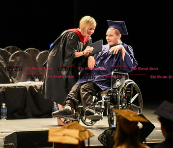 061016 Wesley Bunnell | Staff  The Oakdale Theater in Wallingford was the scene for the 2016 Newington High School Graduation. Travis King accepts his diploma.