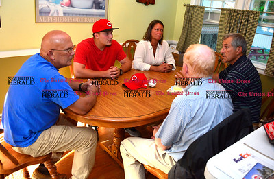 6/14/2016 Mike Orazzi | Staff Matt Blandino and his parents Dave and Kris talk about his contract to play baseball with the Cincinnati Red at the Blandino home on Glendale Drive in Bristol Tuesday evening with Don Titus and Lee Seras, ‎Scouting Supervisor at Cincinnati Reds Baseball Club.