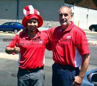 6/14/2016 Mike Orazzi | Staff Jose Delmonte and Tom Mayhew at Flag Car Wash & Detailing on Dallas Avenue during a free car wash promotion Tuesday afternoon.