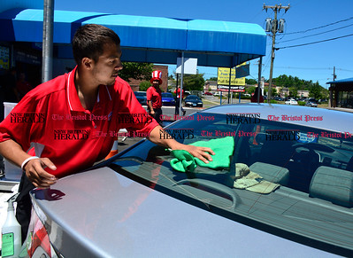 6/14/2016 Mike Orazzi | Staff Ramon Delgado wipes down a car at  Flag Car Wash & Detailing on Dallas Avenue during a free car wash promotion Tuesday afternoon.
