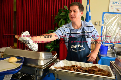 10/10/2015 Mike Orazzi | Staff Frank Tomcak serves a gyro during the A Taste of Greece event at the Saint Demetrios Greek Orthodox Church in Bristol on Saturday.