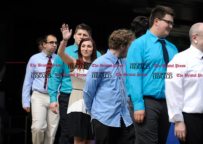6/16/2016 Mike Orazzi | Staff Bristol Tec Education Precision Machining's Aliya Polozhani waves to family while walking with Class of 2016 graduates during Thursday morning's certificate ceremony in Bristol.