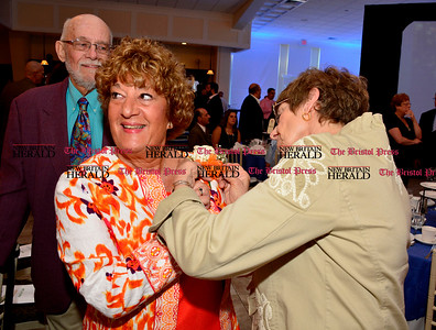6/16/2016 Mike Orazzi | Staff Linda DiMatteo has a corsage pinned by Donna Mchugh during the Bristol Chamber of Commerce 127th annual awards dinner held at the Aqua Turf Club in Southington Thursday evening.