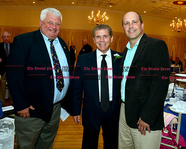 6/16/2016 Mike Orazzi | Staff Tim Bobroske (left) and Tom Barnes (right) with President's Award winner Marty Hurwitz, former Harvest Bakery owner, during the Bristol Chamber of Commerce 127th annual awards dinner held at the Aqua Turf Club in Southington Thursday evening.
