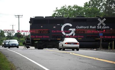 6/16/2016 Mike Orazzi | Staff The freight train crosses Minor Road in Bristol Thursday morning.
