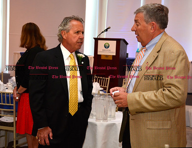 6/16/2016 Mike Orazzi | Staff Donald Soucy (left) talks with John Lodovico during the Bristol Chamber of Commerce 127th annual awards dinner held at the Aqua Turf Club in Southington Thursday evening.