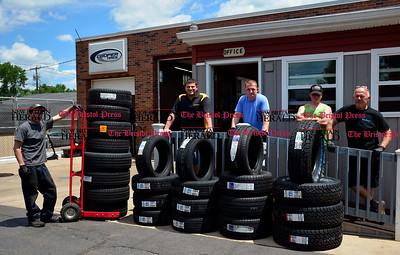 6/17/2016 Mike Orazzi | Staff Tire Depot in Bristol. Left to right: Brian Rogers, David Milo, Steve Ashmore, James Churchill and Don Stevens.