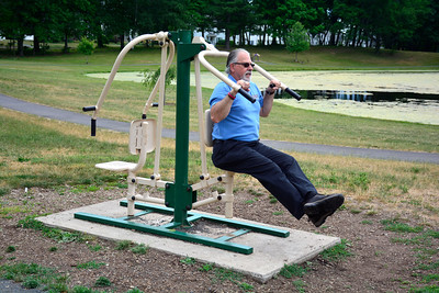 6/28/2016 Mike Orazzi | Staff Bill Flynn spends part of his lunch hour working out in Stanley Quarter Park in New Britain Tuesday.