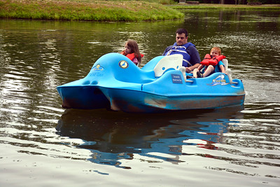 6/28/2016 Mike Orazzi | Staff David Mariani and his children Rieley and Lucas while taking a paddle boat ride in Bristol's Rockwell Park Tuesday.