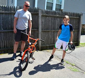6/29/2016 Mike Orazzi | Staff Wayne Kuharski and Ryan Gauvin with his new bike in Bristol Wednesday.