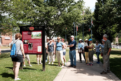 062916  Wesley Bunnell | Staff  The New Britain Industrial Museum hosted a walk along the New Britain Historic Walking Trail gold loop led by volunteer Andrea Kulak on Wednesday morning.  Walkers are shown in Franklin Square.