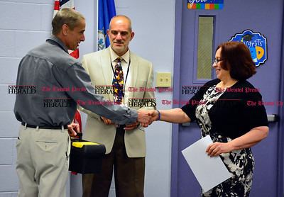 6/7/2016 Mike Orazzi | Staff Dennis Bouchard and Larry Covino, supervisor of Bristol Adult Education, present Workforce Participant Luisa Cisneros a toolbox during a ceremony at the Bristol Adult Education on Tuesday afternoon.