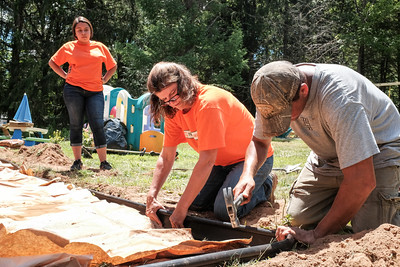 063016  Wesley Bunnell | Staff  Home Depot and volunteers came together for two days to improve a local Marine veteran's backyard.  From L Home Depot volunteer Brenda Salazar, Kelley DeJohn & Kensington veteran Sgt. Matthew Curraro whose home is receiving the improvements.