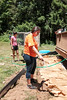 063016  Wesley Bunnell | Staff<br /> <br /> Home Depot and volunteers came together for two days to improve a local Marine veteran's backyard. Head cashier Brenda Salazar prepping a garden bed for flowers.