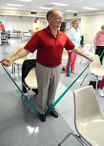 6/30/2016 Mike Orazzi | Staff State Senator Henri Martin while working out with seniors at the Plainville Senior Center Thursday morning.