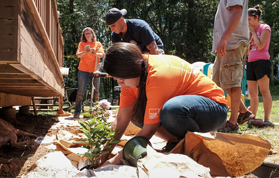 063016  Wesley Bunnell | Staff  Home Depot and volunteers came together for two days to improve a local Marine veteran's backyard. From L in background Home Depot volunteer Kelley DeJohn, Derek Curraro & volunteer Brenda Salazar.
