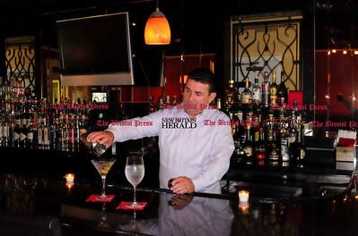 062016  Wesley Bunnell | Staff  Best of Award Winner Cugino's Restaurant of Farmington. Owner Mario Cirikovic behind the bar mixing martini's.
