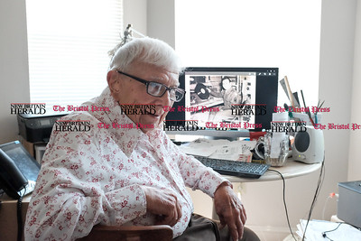 062016  Wesley Bunnell | Staff  Al Cohen, age 98, of Newington spent time on Monday morning to discuss his WWII experiences primarily as a radio operator. A photo of Al from WWII is shown on his computer.