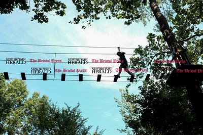 062016  Wesley Bunnell | Staff  Visitors to Go Ape Treetop Adventure in AW Stanley Park are shown on Monday afternoon. Kathleen Kelly of Evergreen Park IL is shown silhouetted against the sky.
