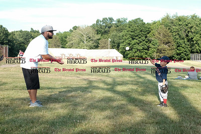 062016  Wesley Bunnell | Staff  David Ramirez Sr plays catch with his son David Jr, age 4, before the start of his game in AW Stanley Park on Monday afternoon.