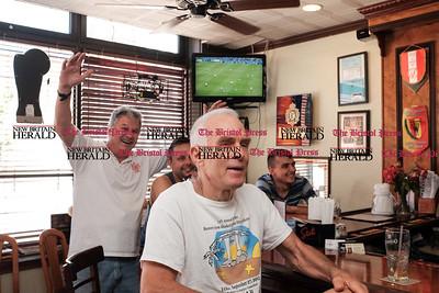 062116  Wesley Bunnell | Staff  Soccer fans at Staropolska Restaurant watched Poland defeat Ukraine 1-0 on Tuesday afternoon. Peter Potaski with restaurant owner Bogdan Malimowski behind him and John Targonski & Ivan Leveytskyy.