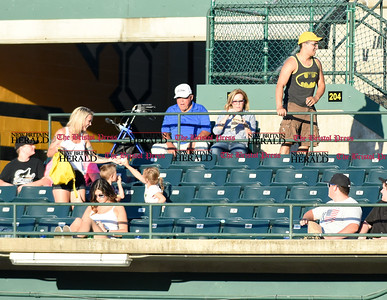 062116  Wesley Bunnell | Staff  New Britain Bees took on visiting Somerset Patriots on Tuesday evening in the second of three games. A fan catches a foul ball and gives it away to a young girl.