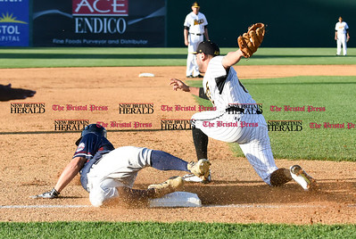 062116  Wesley Bunnell | Staff  New Britain Bees took on visiting Somerset Patriots on Tuesday evening in the second of three games. Steve Carrillo #4 applies the tag but the runner was ruled safe.