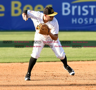 062116  Wesley Bunnell | Staff  New Britain Bees took on visiting Somerset Patriots on Tuesday evening in the second of three games. Steve Carrillo #4 fields and throw to first for the out.