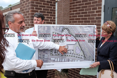 062216  Wesley Bunnell | Staff  A walk through was held at Smalley Academy to highlight the need for a multi million dollar renovation the town is voting on Wednesday evening.  New Britain School's Chief Operations Officer Paul Salina points out the existing school in white and the proposed changes. Holding the map is Ray Moore Chief Facilities Officer & Smalley Academy Principal Elsa Saavedra.