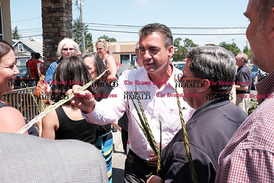 062216  Wesley Bunnell | Staff  Owner Mohegan Holdings held the opening of their new newest smashburger location on Queen St in Southington on Wednesday.  The Southington Chamber of Commerce was present along with local politicians for the ribbon cutting. Tribal Council member Bruce Bozsum presented sweet grass as a gift of prosperity and good will.