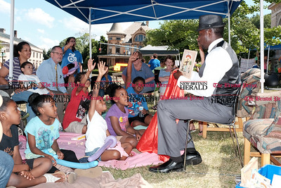 "062216  Wesley Bunnell | Staff  Activities were held on the front lawn of the New Britain Public Library from 10-4 on Wednesday. The reading tent's guest readers rotated every half hour throughout the day entertaining the children.  Akintunde ""Tunde"" Sogunro read his own book Mama Stitches.  The story is about a mother dog who stitches clothes for the homeless and covers them with love."