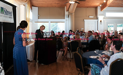 062216  Wesley Bunnell | Staff  Main Street Community Foundation held their 2016 Scholarship Reception on Wednesday evening at Hawk's Landing Country Club in Southington.  President & CEO Susan Sadecki at the microphone announcing an award winner in front of a packed reception hall.