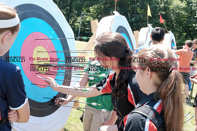 062516  Wesley Bunnell | Staff  The Nutmeg State Games & CTAA Archery Tournament drew competitors from several states to Hungerford Park on Saturday morning.  Competitors check their targets, from L Meredith Reynholds, Hana Tabit & Meghan Domanico all of Hall's Arrow All Stars.