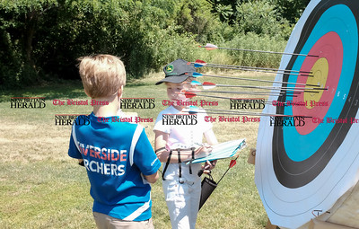 062516  Wesley Bunnell | Staff  The Nutmeg State Games & CTAA Archery Tournament drew competitors from several states to Hungerford Park on Saturday morning.  Whitney Williams, age 8, of Concord Mass checks her target with the help of Alexander Bruno, age 9, of Hudson Mass.